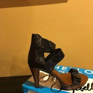 Black leather strapped  heel - slightly used